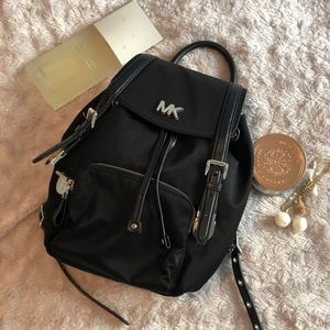 Michael kors jet black backpack